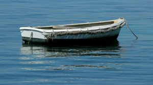 stock-footage-old-fishing-boat-description-old-wooden-fishing-boat-on-the-calm-sea